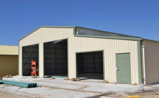 Classic Cream™ with Pale Eucalypt® Trim Industrial Building with Attached Workshop