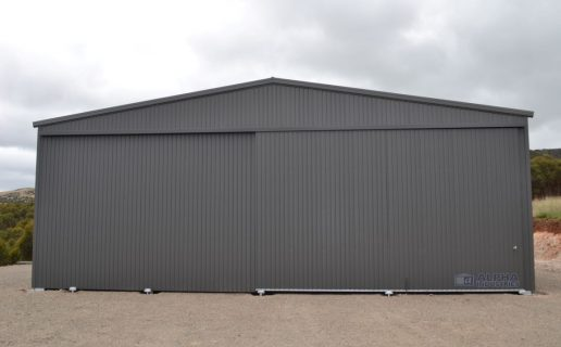 Industrial Building in Woodland Grey® with Gable Sliding Doors